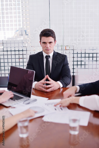 business man  on a meeting in offce with colleagues in backgroun