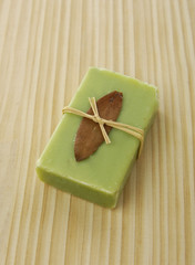 handmade green soaps on wooden board