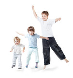 three children jump on white