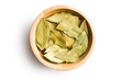 bay leaves in wooden bowl