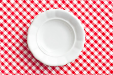 white old plate on checkered napkin