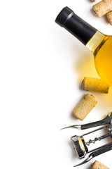 wine cork, corkscrew and bottle of white wine