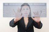 business lady pushing transparent keyboard on the whiteboard.