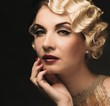 Elegant blond retro woman  in golden dress