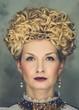 Portrait of beautiful haughty queen in royal dress