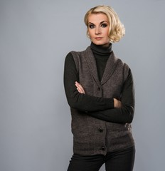 Elegant blond woman in casual brown clothes