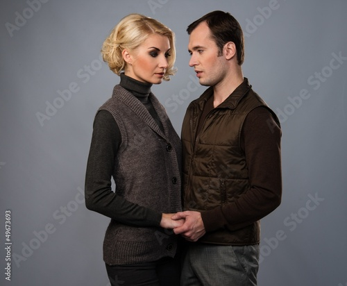 Young man and woman in casual brown wear