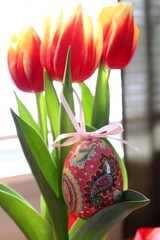 Pretty tulips and decorative Easter egg