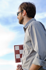 Man holding a chessboard
