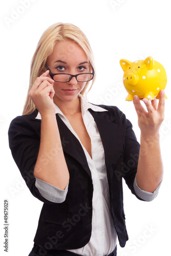 Young woman watching piggy bank