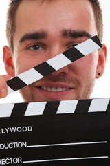 Young guy with clapper board