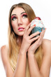 blonde girl with healthy hair colorful make up holding cupcake