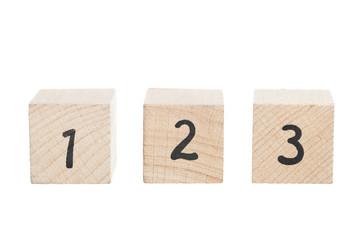 ABC 123 Arranged Using Wooden Blocks.