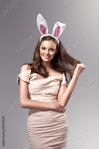 picture of young woman wearing pink easter bunny costume
