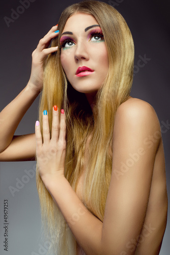 portrait of beautiful girl with healthy hair colorful nails