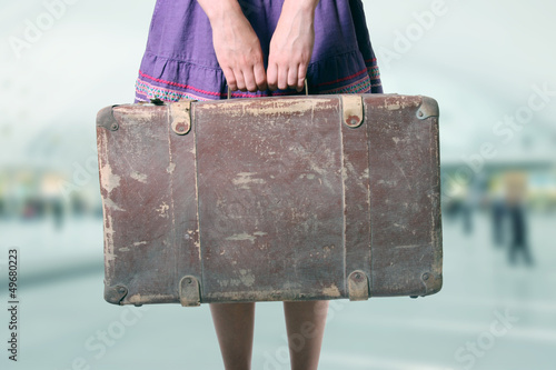 woman with luggage at the airport - 49680223