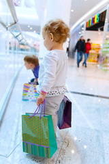 Children with bags in mall