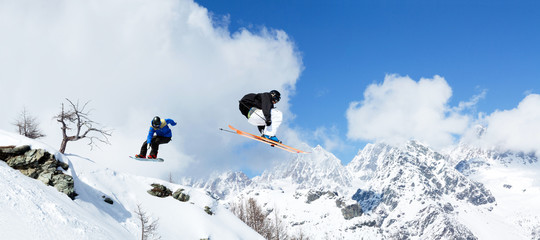 skier vs. snowboarder