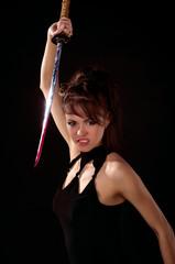 Beautiful woman in black dress with katana sword