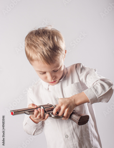 Kid holds the gun