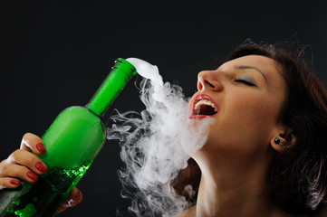Beautiful girl with green foggy bottle