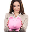 beautiful woman with piggy bank