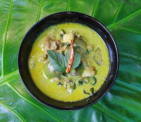 Green pork Curry on green leaf , Thai cuisine