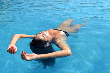 Woman relaxing in the pool