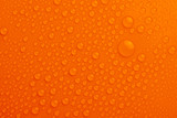 Water drops on orange background
