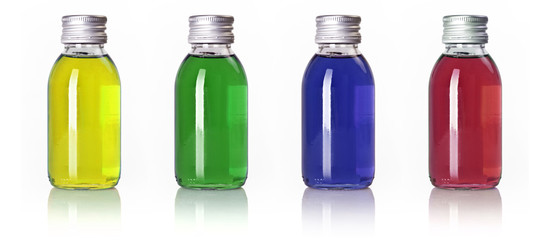 Bottles in a row with colored liquid