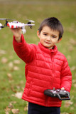 Young boy with quadcopter drone. poster