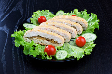 Chicken roll, lettuce, tomatoes and cucumbers