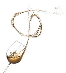 White wine splashing out of glass, isolated on white background