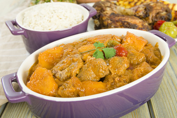 Lamb & sweet potato peanut stew with  rice & jerk chicken.
