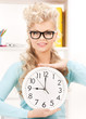 attractive businesswoman with clock