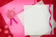 Paper card and pink envelope with sealing wax stamp
