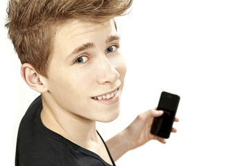 Teenager holding smartphone and smiles