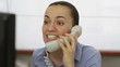 Businesswoman screaming into a phone, close up