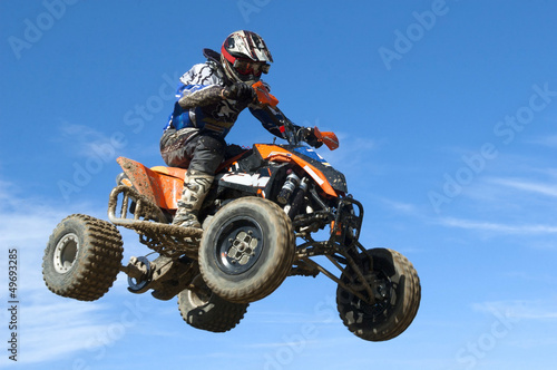 quad jumping on blue sky