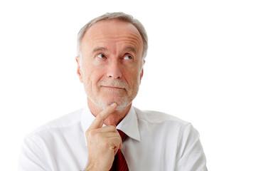 Senior business man thinking