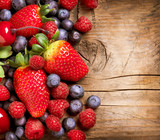 Berries on Wooden Background. Organic Berry over Wood - 49695012