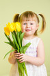 cute little girl with flower gift on green background