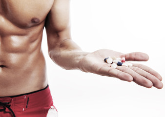 Muscular Male holding supplements