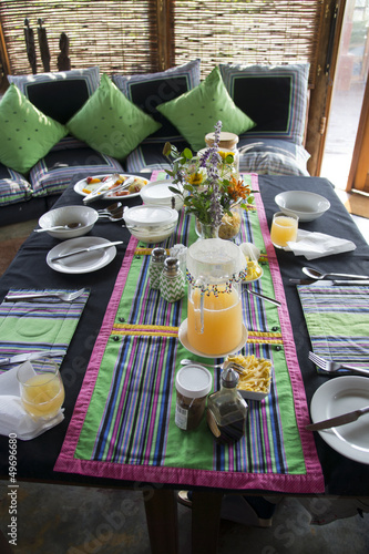 Colorful breakfast table in Venda style