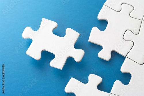 Assembling jigsaw puzzle pieces.