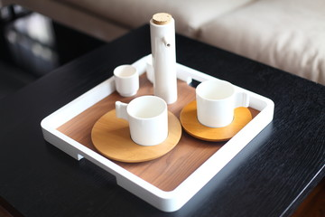White teacup over black table