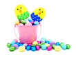Pink Easter pail with colorful chocolate eggs and candy