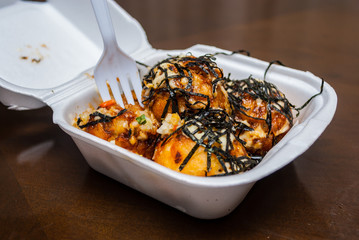 Takoyaki with seaweed in foam box