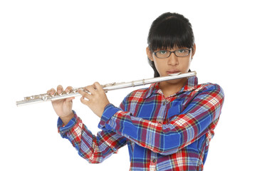 Girl plays a flute Isolated on white background.