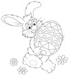 Easter Bunny carrying a decorated Easter egg